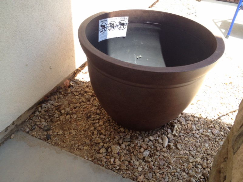 Place The Large Pot Where You Want The Planter Located.